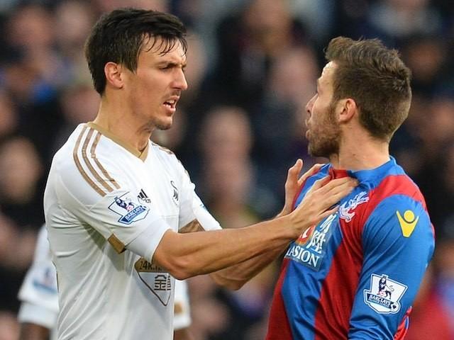 Swansea's Jack Cork confronts Crystal Palace's Yohan Cabaye on December 28, 2015