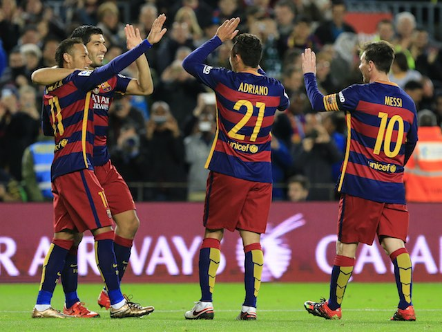 Barca players celebrate during the game between Barcelona and Real Betis on December 30, 2015)