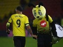 Troy Deeney shakes hands with Harry The Hornet during the game between Watford and Newcastle United on January 9, 2016