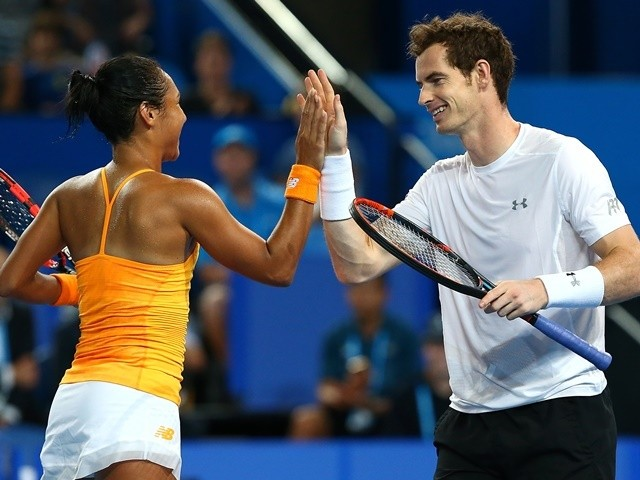 Heather watson and andy murray of great britain celebrate a point in
