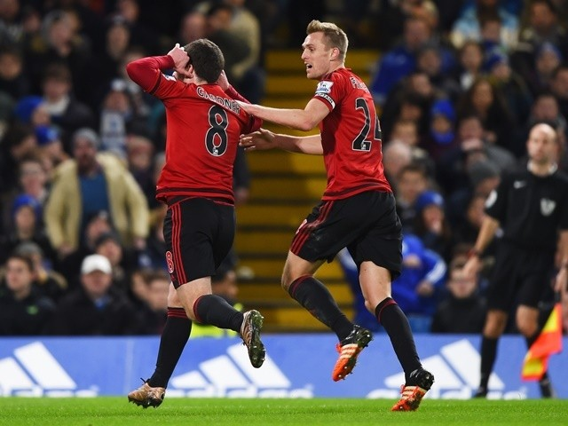 Craig Gardner of West Bromwich Albion celebrates scoring his team's first goal with his teammate Darren Fletcher against Chelsea at Stamford Bridge on January 13, 2016