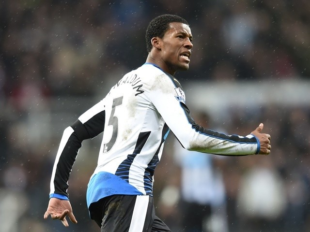 Georginio Wijnaldum of Newcastle United celebrates as he scores their first goal during the Premier League match against Manchester United at St James' Park on January 12, 2016