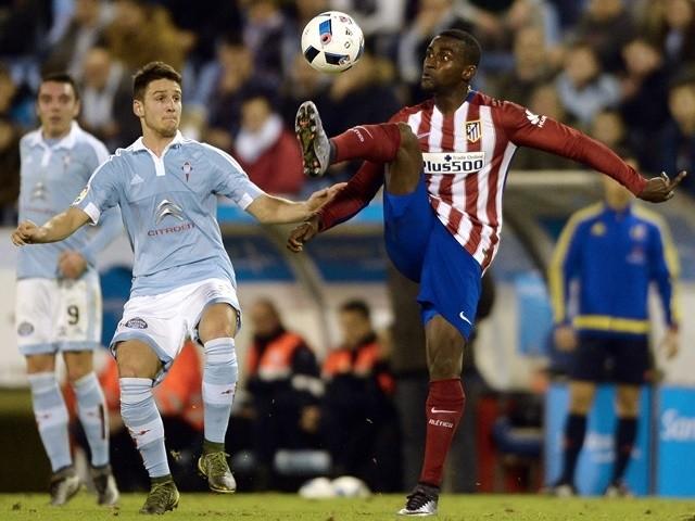 Atletico Madrid's Jackson Martinez vies with Celta Vigo's Nemanja Radoja on January 20, 2016