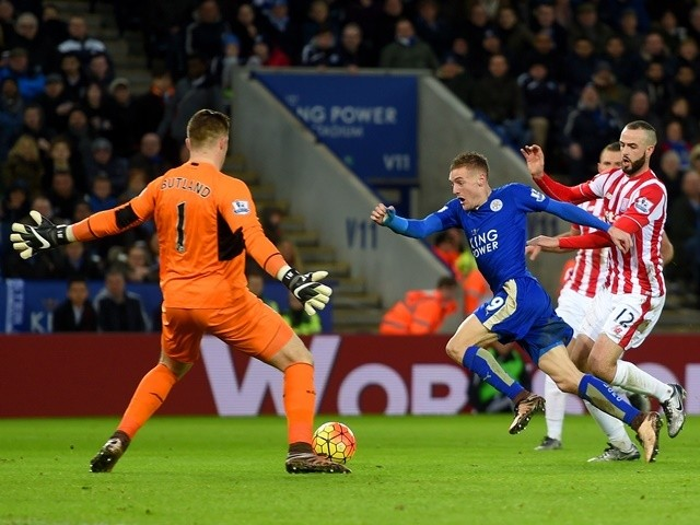 Jamie Vardy of Leicester City goes past Jack Butland of Stoke City to score his team's second goal on January 23, 2016
