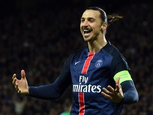 PSG forward Zlatan Ibrahimovic does his best impression of a Picasso painting after scoring in the 2-0 win over Saint-Etienne on Jan 31, 2016