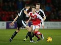 Nick Haughton and Conor Hourihane in action during the League Trophy semi-final between Fleetwood Town and Barnsley on February 4, 2016