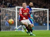 Wayne Rooney and Cesc Fabregas in action during the Premier League game between Chelsea and Manchester United on February 7, 2016