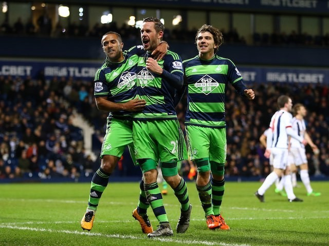 Gylfi Sigurdsson celebrates scoring during the Premier League game between West Brom and Swansea on February 2, 2016