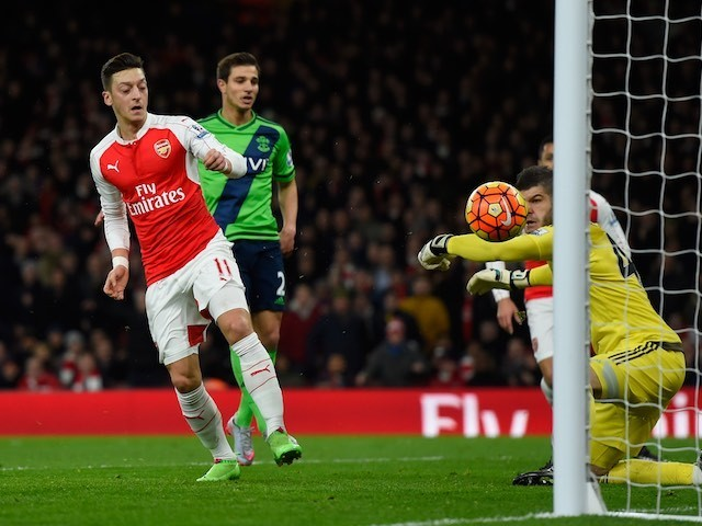 Mesut Ozil has a shot saved by Fraser Forster during the Premier League game between Arsenal and Southampton on February 2, 2016