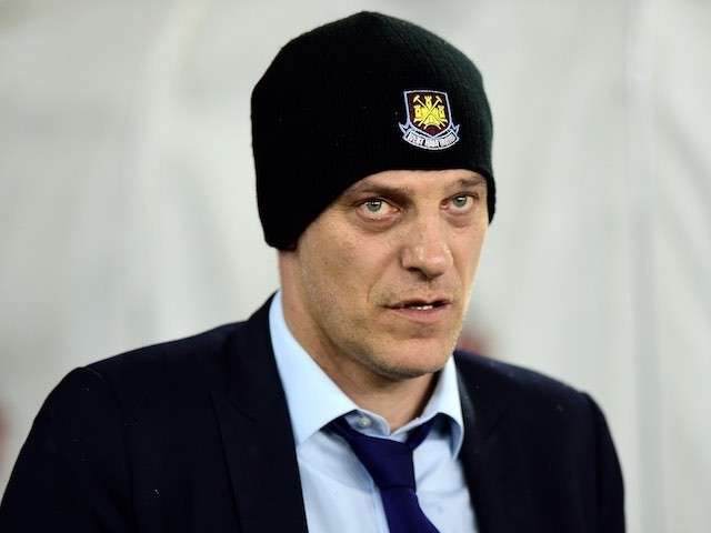 Slaven Bilic models the West Ham beanie during the Premier League game between Southampton and West Ham United on February 6, 2016