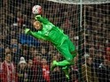 Darren Randolph makes a save during the FA Cup fourth-round replay between West Ham United and Liverpool on February 9, 2016