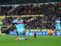 Dimitri Payet of West Ham United scores his team's first goal against Norwich City on February 13, 2016