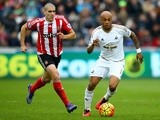 Andre Ayew of Swansea City and Oriol Romeu of Southampton compete for the ball on February 13, 2016