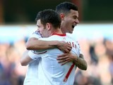 James Milner and Philippe Coutinho celebrate during the Premier League game between Aston Villa and Liverpool on February 14, 2016