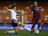 Santi Mina takes on Adriano during the Copa del Rey semi between Valencia and Barcelona on February 10, 2016