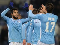 Lazio's Felipe Anderson and Alessandro Matri congratulate each other after a goal in their side's 5-2 victory over Verona on February 11, 2016