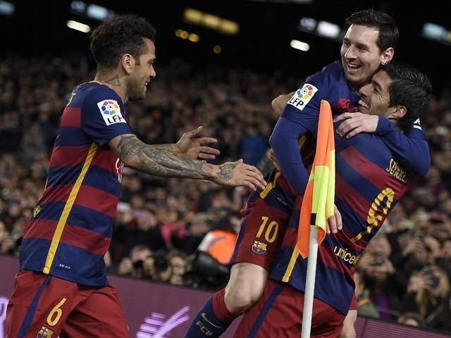 Barcelona's Luis Suarez celebrates a goal with Lionel Messi and Dani Alves during the match against Celta Vigo on February 14, 2016