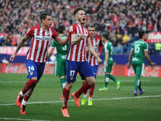 Saul Niguez celebrates with Jose Maria Gimenez after scoring his team's second goal during the La Liga match between Atletico Madrid and Eibar on February 6, 2016