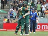 South African batsmen AB de Villiers and David Wiese congratulate each other on scoring the final run to win the final ODI against England on February 14, 2016