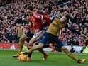 Little Adnan Januzaj is bullied by Gabriel during the Premier League game between Manchester United and Arsenal on February 28, 2016