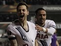 Ryan Mason yanks away at his shirt after scoring during the Europa League game between Tottenham Hotspur and Fiorentina on February 25, 2016