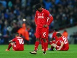 Daniel Sturridge and Liverpool teammates react after Manchester City win the League Cup on February 28, 2016