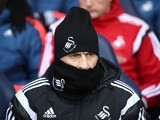 Francesco Guidolin attempts to go unnoticed during the Premier League game between Tottenham Hotspur and Swansea City on February 28, 2016