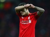 Philippe Coutinho reacts after Manchester City win the League Cup on February 28, 2016