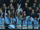 Vincent Kompany lifts the League Cup trophy on February 28, 2016