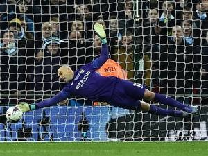 Willy Caballero saves Adam Lallana's penalty during the League Cup final between Liverpool and Manchester City on February 28, 2016