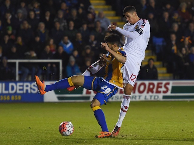 Chris Smalling shoots past Nat Knight-Percival during the FA Cup game between Shrewsbury Town and Manchester United on February 22, 2016
