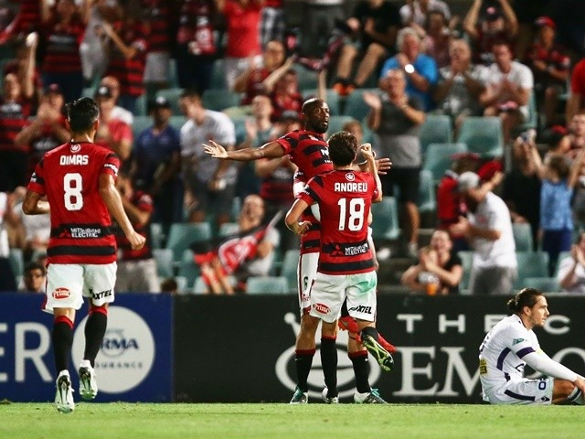 Romeo Castelen celebrates after scoring a goal in the match between the Western Sydney Wanderers and Perth Glory on February 26, 2016