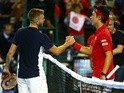 Dan Evans of Great Britain and Kei Nishikori of Japan shake hands following their singles match on day one of the Davis Cup World Group on March 4, 2016