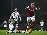 Mark Noble of West Ham United jumps a challenge from Erik Lamela of Tottenham Hotspur on March 2, 2016