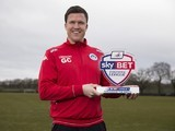 Gary Caldwell poses with his manager of the month award for February 2016