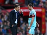 Slaven Bilic has a word with Andy Carroll during the FA Cup game between Manchester United and West Ham United on March 13, 2016