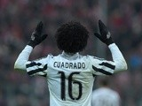 Juan Cuadrado celebrates scoring the second goal during the Champions League round-of-16 second leg between Bayern Munich and Juventus on March 16, 2016
