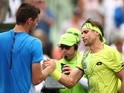 David Ferrer shakes hands at the net after his straight-sets victory against Taylor Fritz at the Miami Open on March 25, 2016