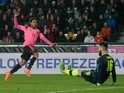 Ikechi Anya of Scotland scores past Czech goalkeeper Tomas Koubek on March 24, 2016