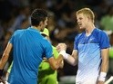 Novak Djokovic shakes hands at the net after his straight-sets victory against Kyle Edmund at the Miami Open on March 25, 2016