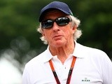Sir Jackie Stewart walks in the paddock during previews to the Formula 1 Grand Prix of Singapore at Marina Bay Street Circuit on September 17, 2015
