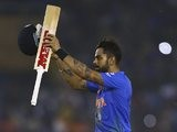 Virat Kohli of India celebrates after the World Twenty20 victory over Australia in Mohali on March 27, 2016