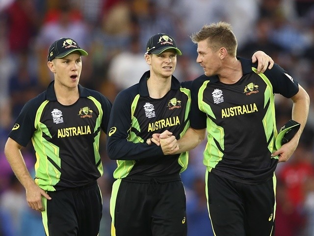 Adam Zampa, Steve Smith and James Faulkner of Australia celebrate victory against Pakistan on March 25, 2016