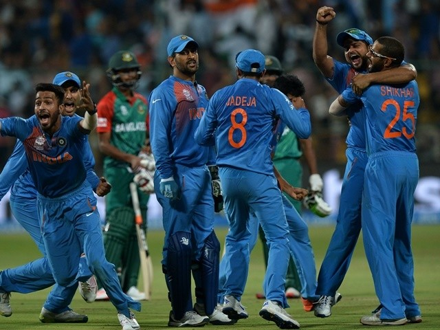 Assorted Indians celebrate the wicket that led to the victory of India by two runs during the World T20 in Bangalore on March 23, 2016