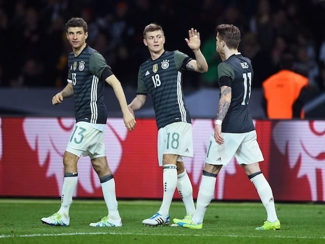 Toni Kroos celebrates with Thomas Muller and Marco Reus during the international friendly between Germany and England on March 26, 2016