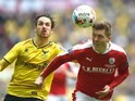 Danny Hylton and Alfie Mawson in action during the League Trophy final between Oxford United and Barnsley on April 3, 2016