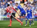 Jamie Vardy and Virgil van Dijk in action during the Premier League match between Leicester City and Southampton on April 3, 2016