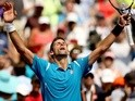 Novak Djokovic celebrates his win over David Goffin during the semi-finals of the Miami Open on April 1, 2016