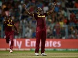 Carlos Brathwaite celebrates dismissing Jos Buttler during the World Twenty20 final between England and the West Indies at Eden Gardens on April 3, 2016