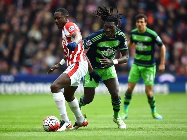 Giannelli Imbula and Bafetimbi Gomis in action during the Premier League match between Stoke City and Swansea City on April 2, 2016